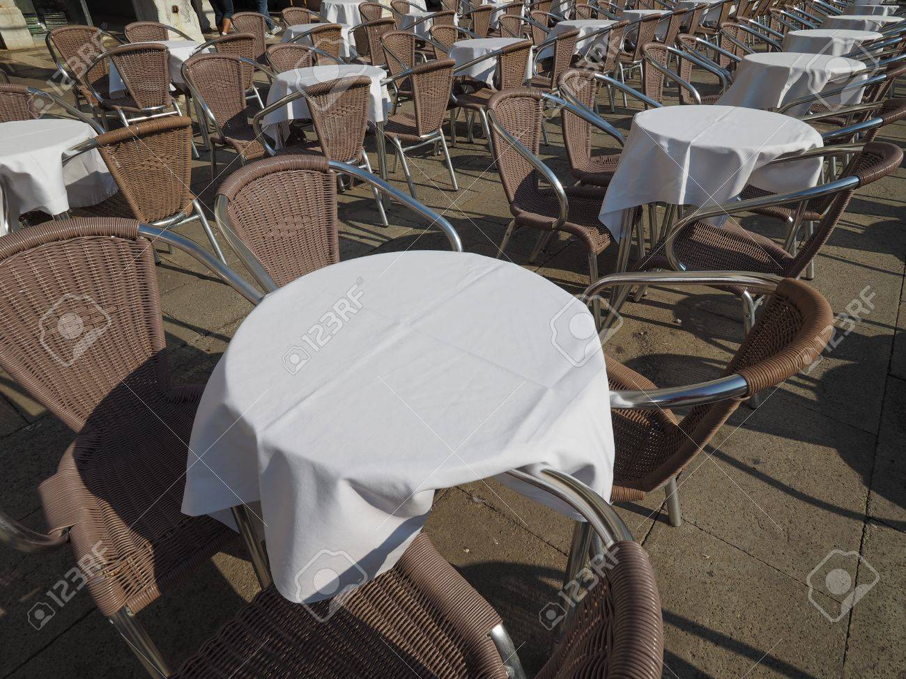 Many tables and chairs at an outdoor alfresco bar stock photo 68718266