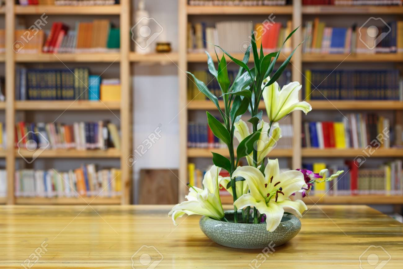 Flower Arrangement And Bookshelf Stock Photo