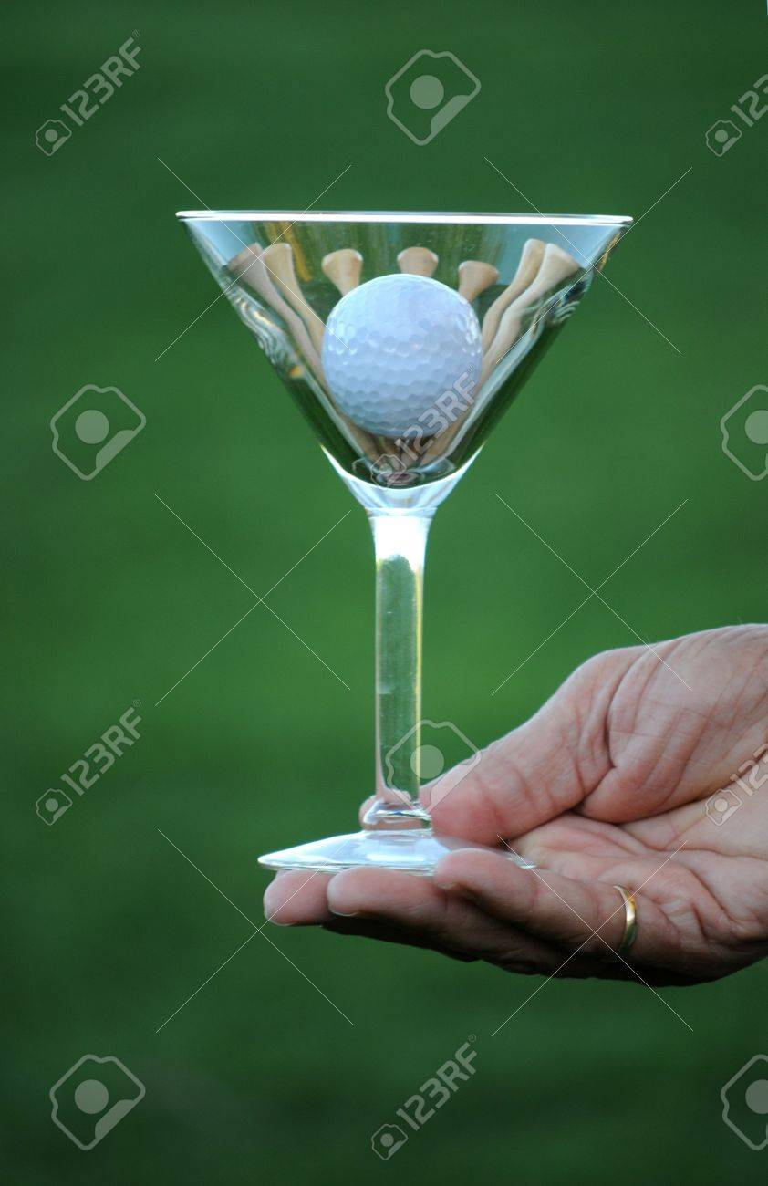 golf ball and tees in martini glass Stock Photo - 5256289