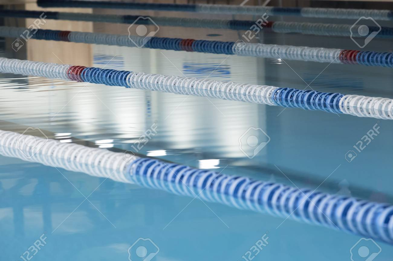 swimming pool lane lines background. Closeup Of Lane Marker Buoys In A Indoor Swimming Pool Useful As Background - Focus Lines V