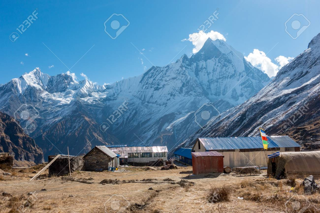 A group of buildings at the Base Camp of the Annapurna Mountains. - 107675648