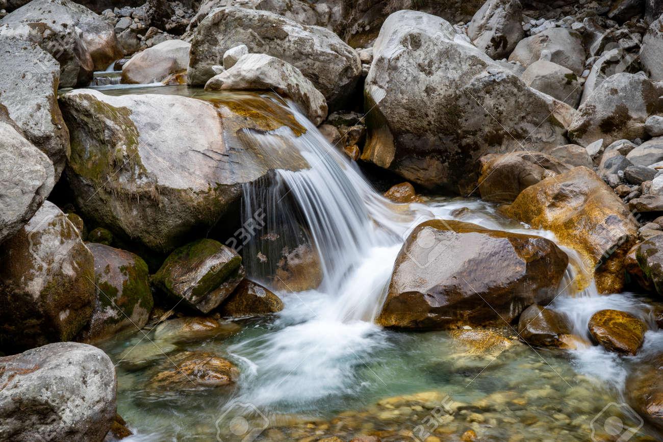 A small waterfalls among the rocks. - 169836056