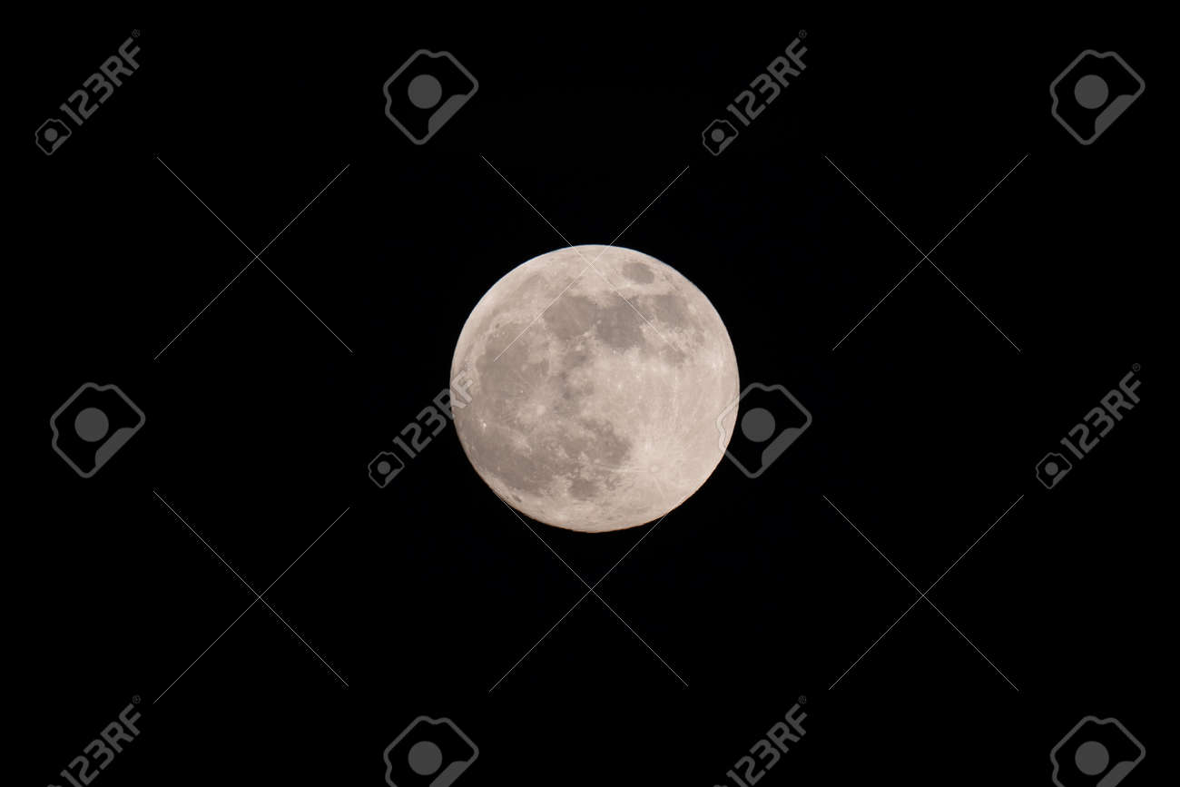 The light of the full moon in the night sky. - 170388680