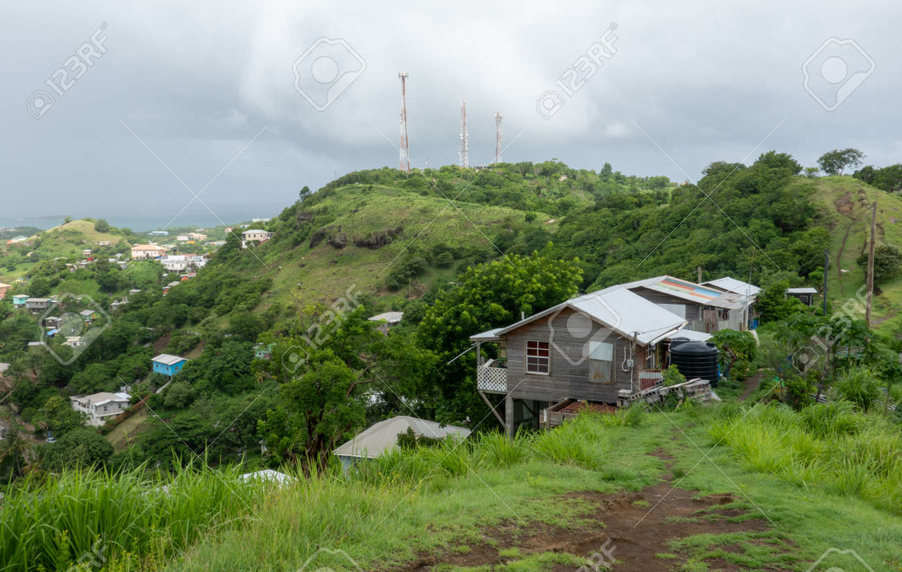 A house perched on the side of a hill in Grenada. - 171537413