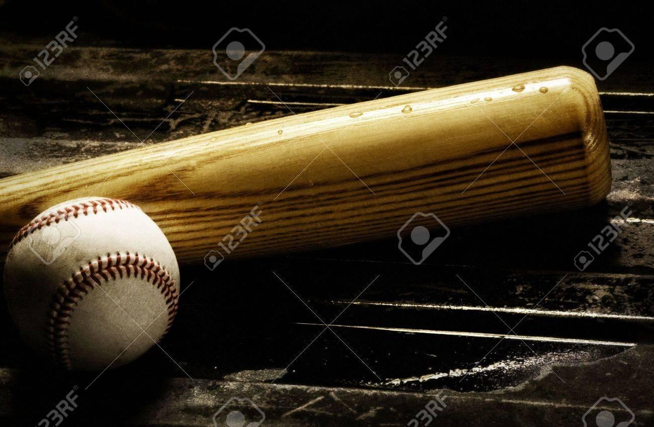 Wooden baseball bat and baseball on a black background Stock Photo - 5373138
