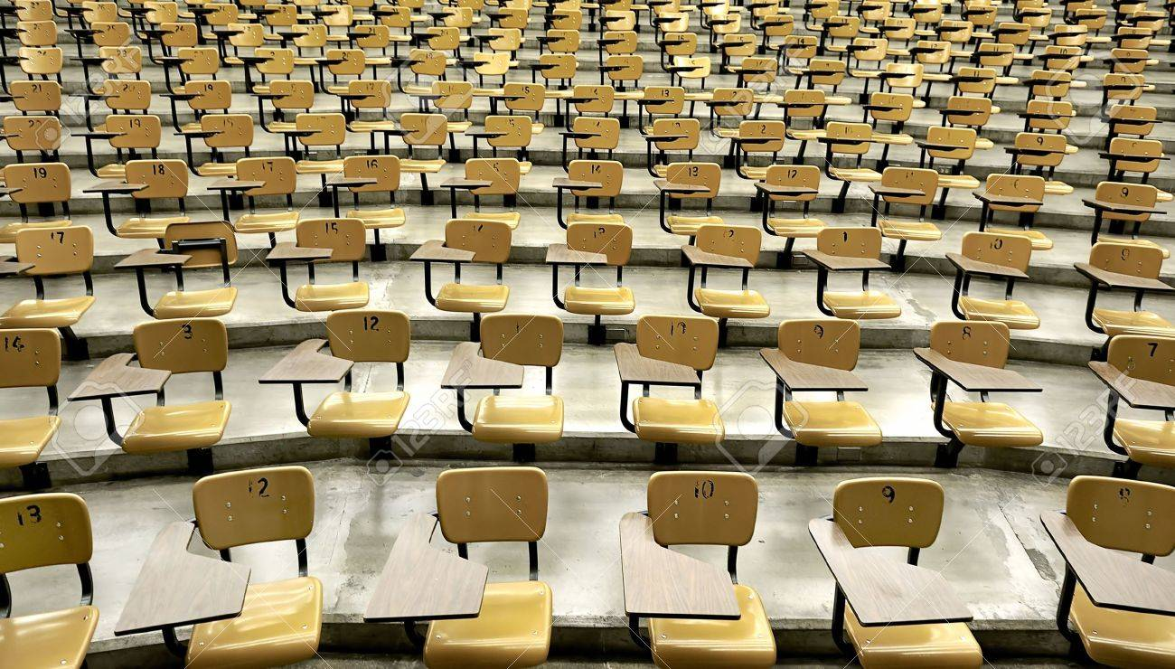 A large amount of empty seats with tables in a lecture hall Stock Photo - 5373199