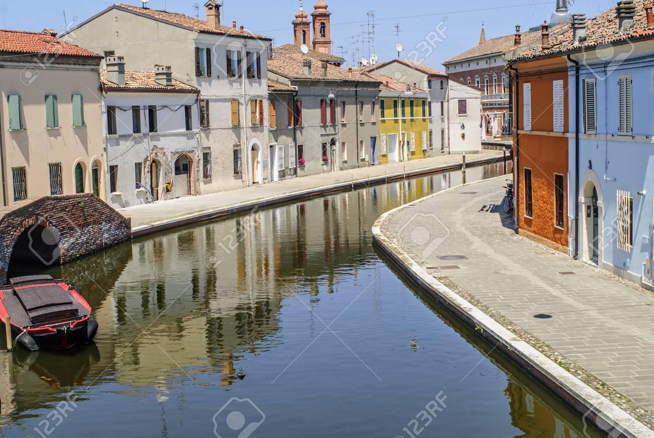 Comacchio (Ferrara, Emilia Romagna, Italy) - Winding canal with boat and colorful houses Stock Photo - 17272021