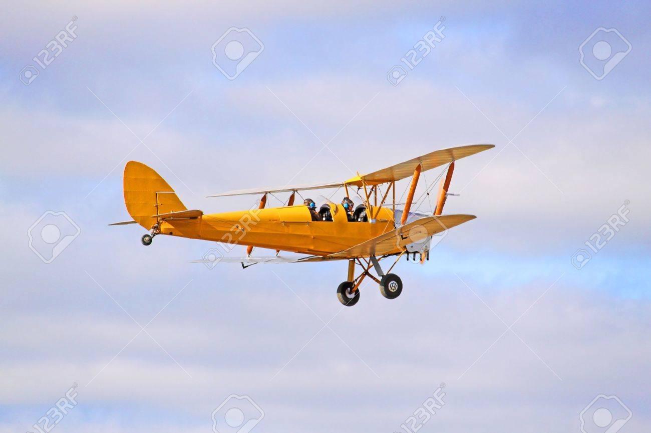 1942 Yellow DH82 Tiger Moth Bi-plane. Gipsy Major - Four cylinder inline engine. Stock Photo - 4850379