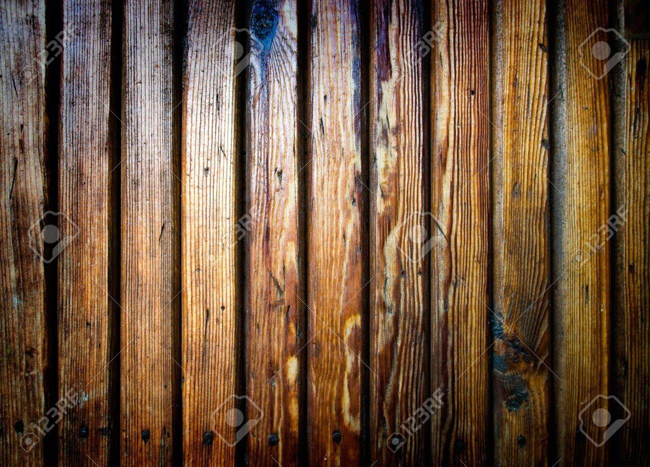Grungy scratched wooden plank. Dirty and damaged wood with nails Stock Photo - 5120870