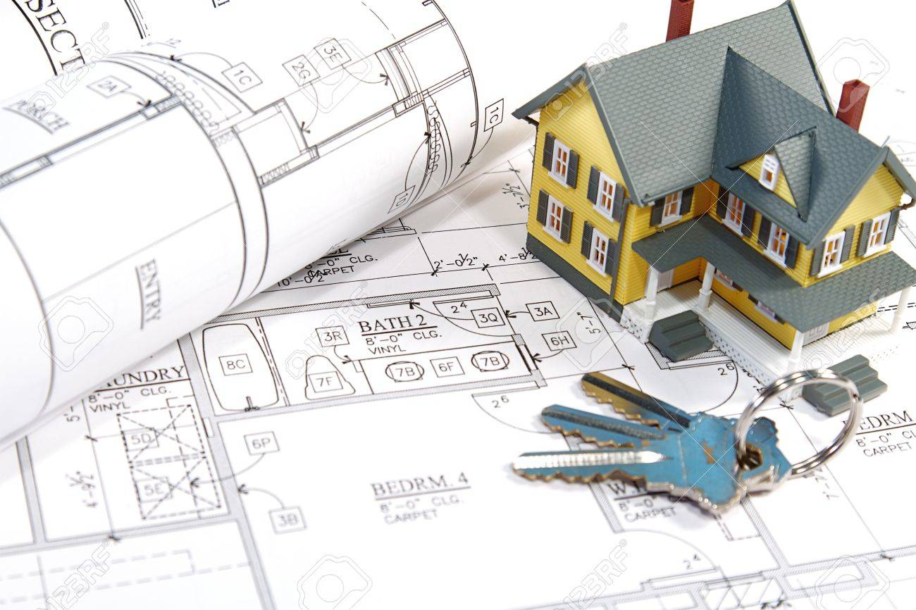 Residential home blueprints with a hand made house