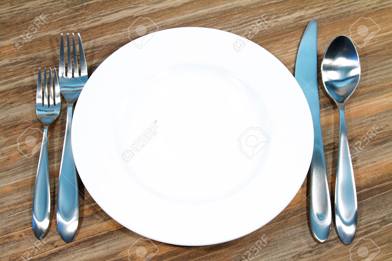 Modern silverware arranged in a place setting on a table Stock Photo - 9049959 & Modern Silverware Arranged In A Place Setting On A Table Stock Photo ...
