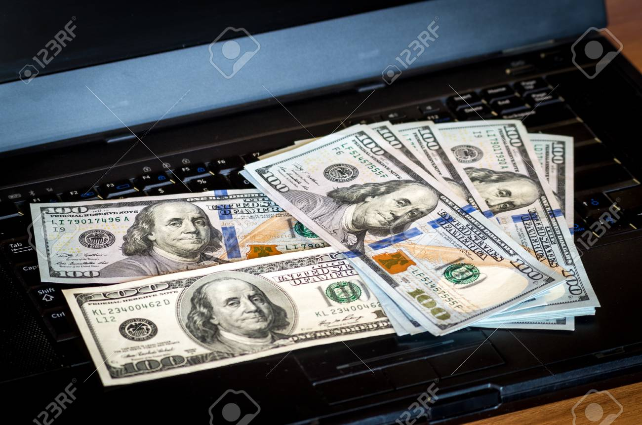 Bunch Of Dollar Bill Notes Thrown On A Laptop Keyboard Featured Defocused Bokeh Stock P O