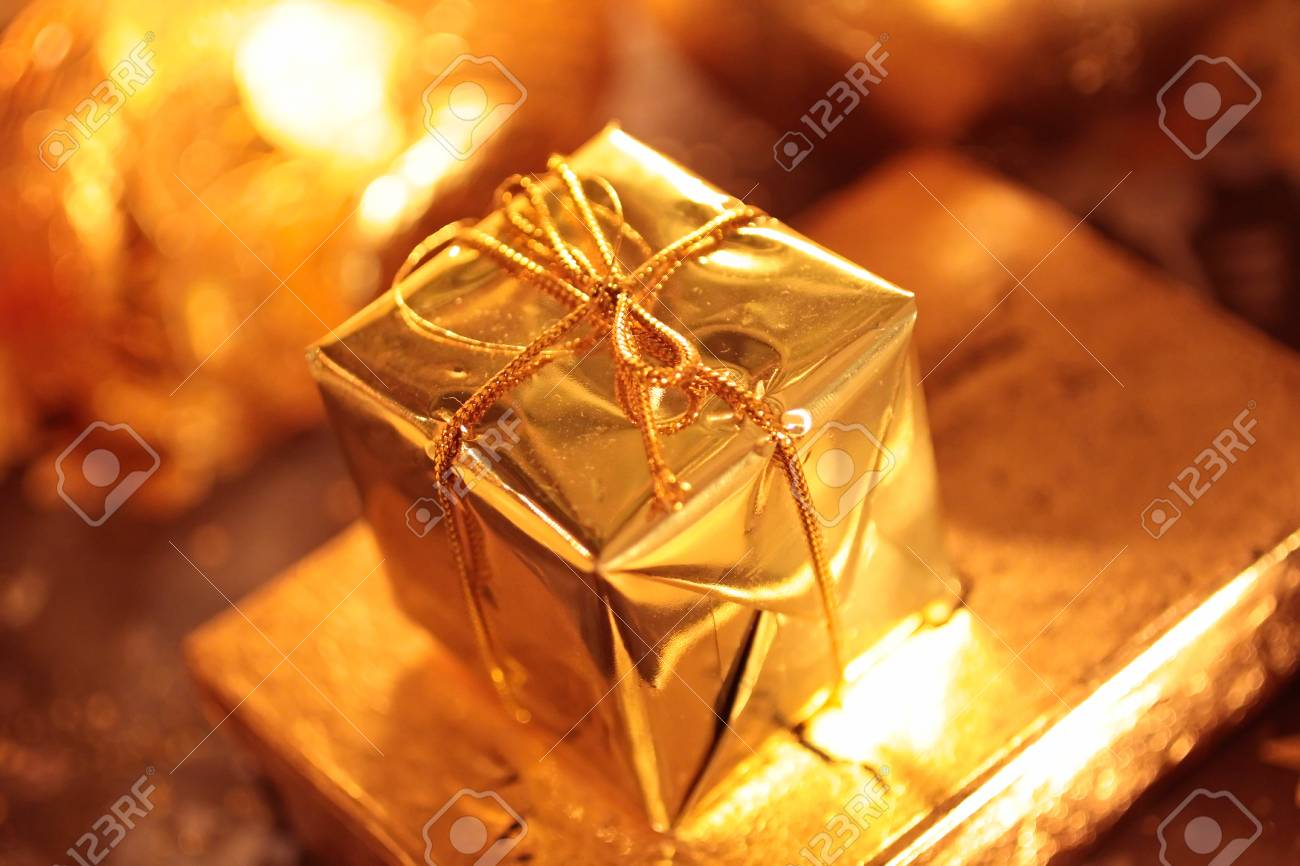 Small sparkling golden packet as Christmas decoration Stock Photo - 10554235