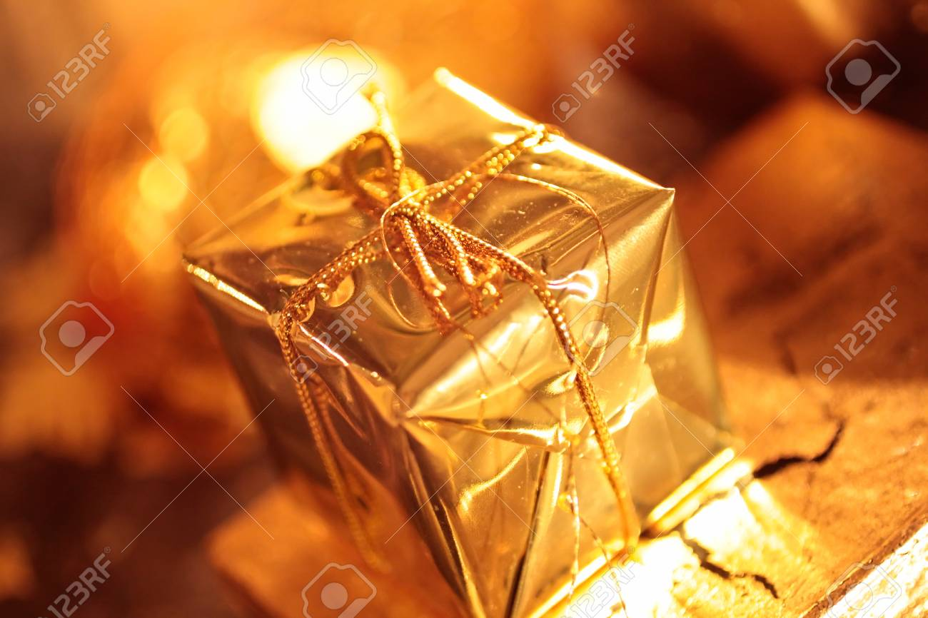 Small sparkling golden packet as Christmas decoration Stock Photo - 10624055