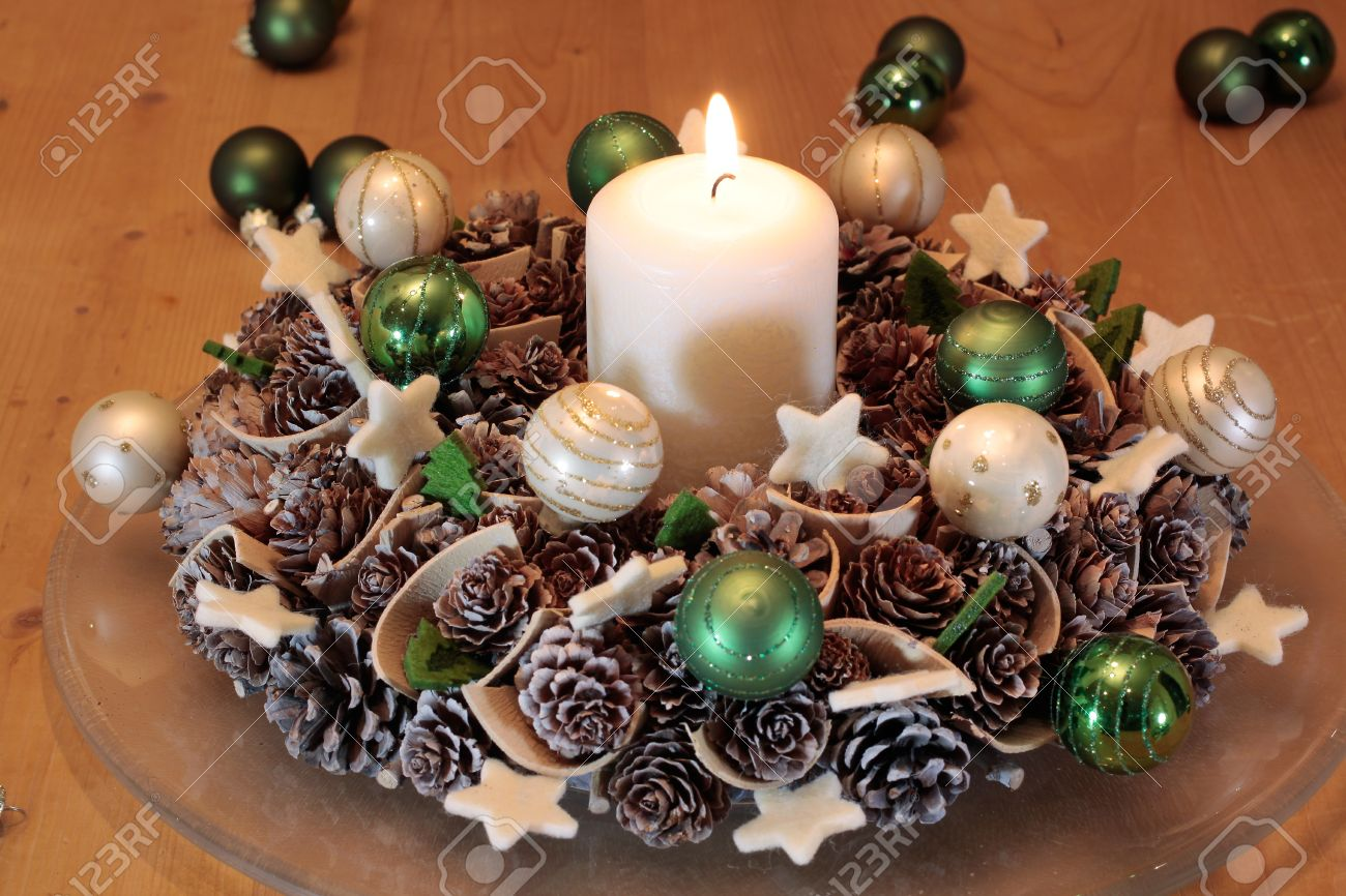 advent wreath with pine cones and burning candle stock photo