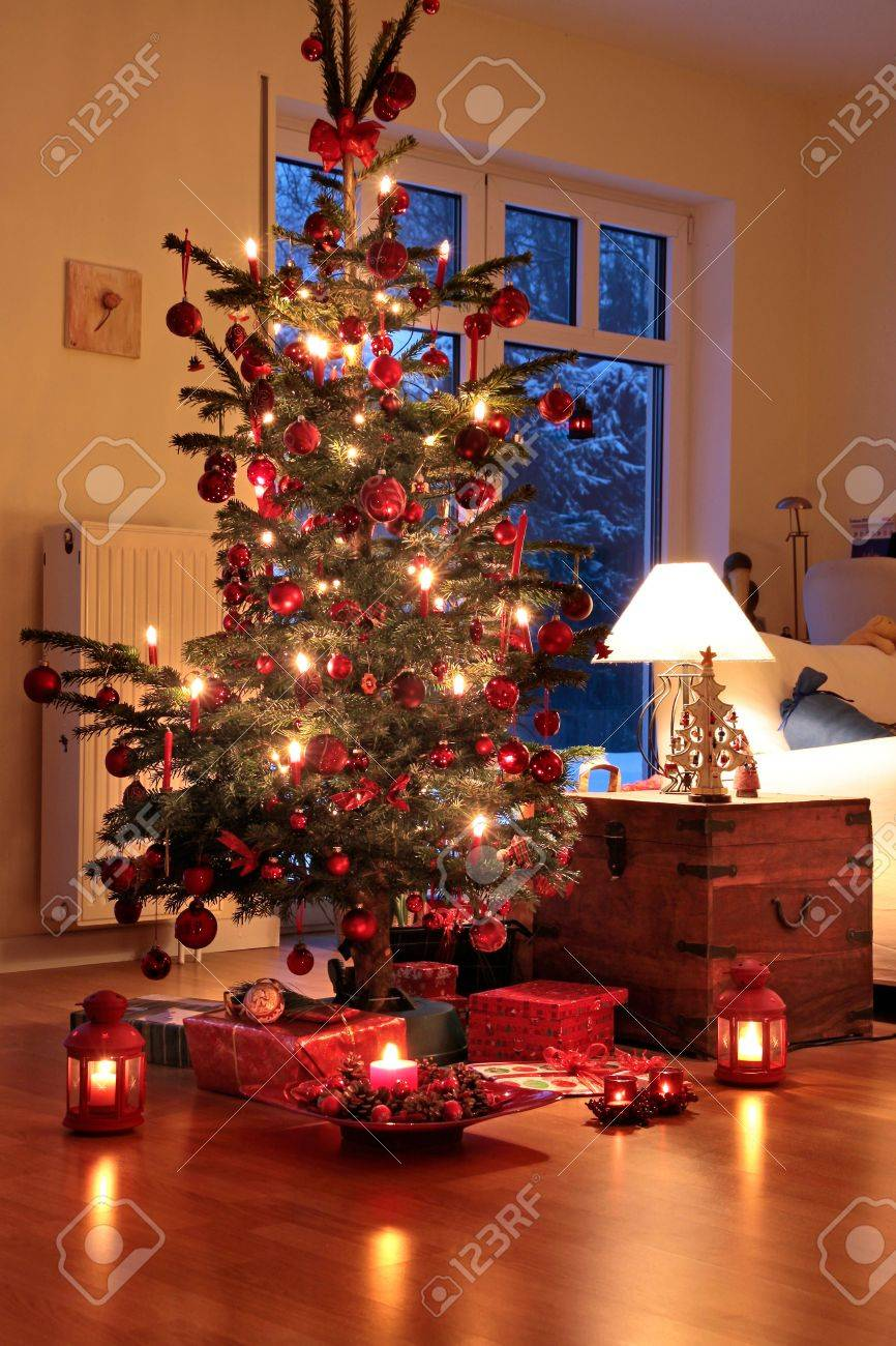 Illuminated Christmas Tree In German Home With Candlelights Stock ...