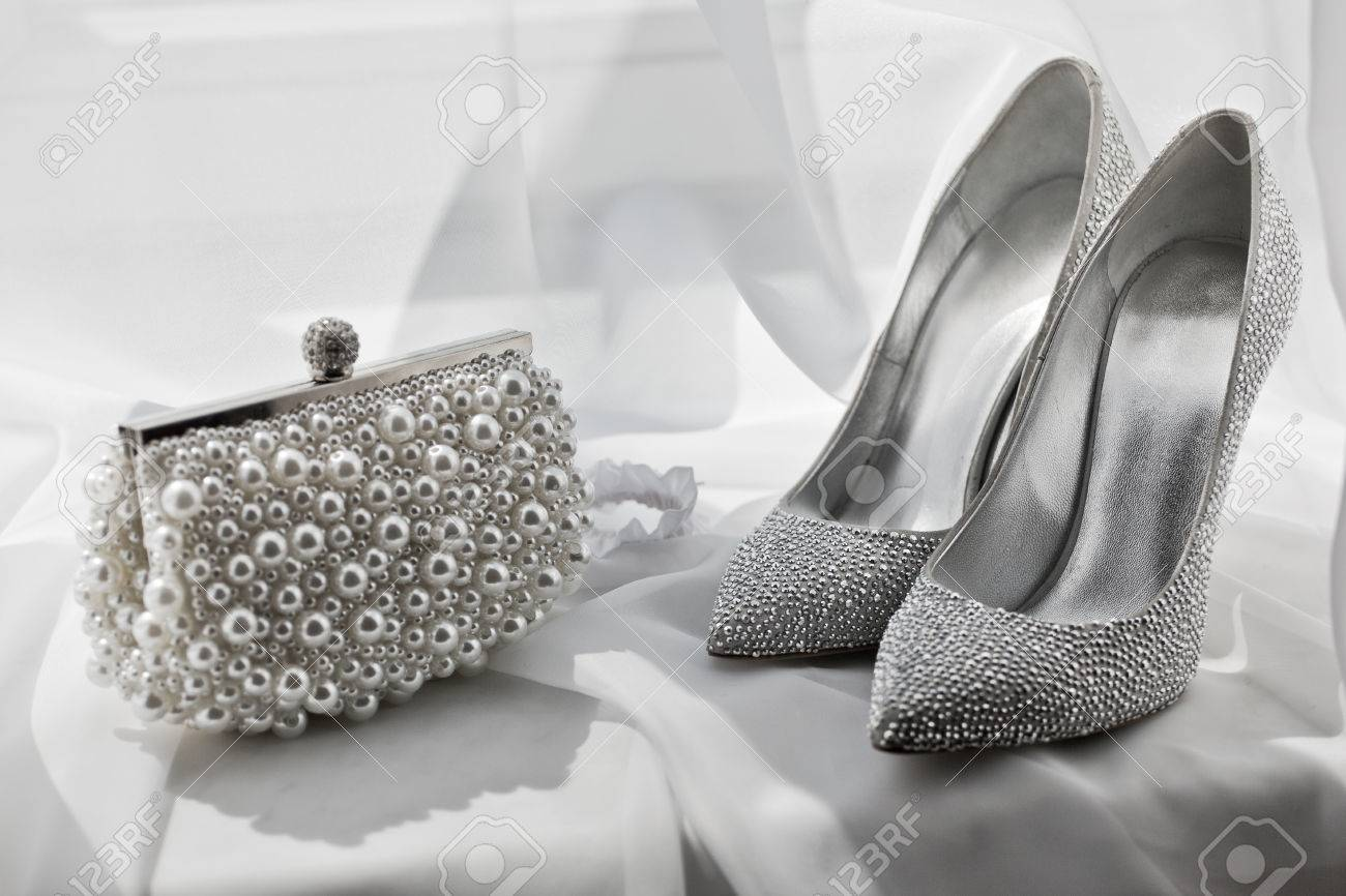 33a6196cbb820 Glitter Silver Shoes And Clutch Bag On White Stock Photo, Picture ...