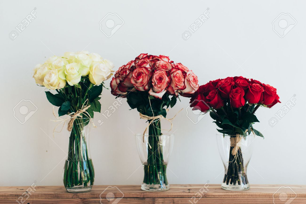 Bunch of flowers images stock pictures royalty free bunch of bunch of flowers bouquets of roses in three glass vases next to a watering can dhlflorist Image collections