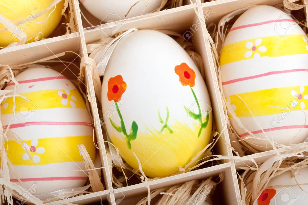 closeup of assorted colorful painted easter eggs in a wodden box Stock Photo - 17164511