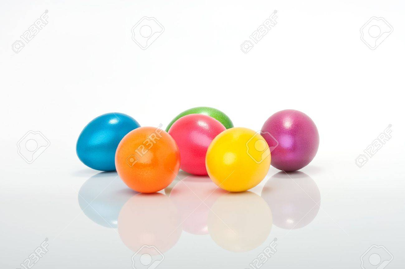 lot of colorful orange, violett, blue, red, yellow, purple easter eggs isolated against white background Stock Photo - 17164482