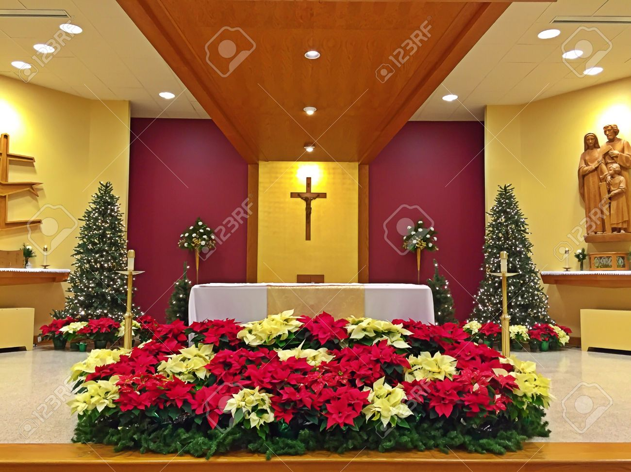 A Church Altar Decorated With Flowers On Christmas Day Stock Photo