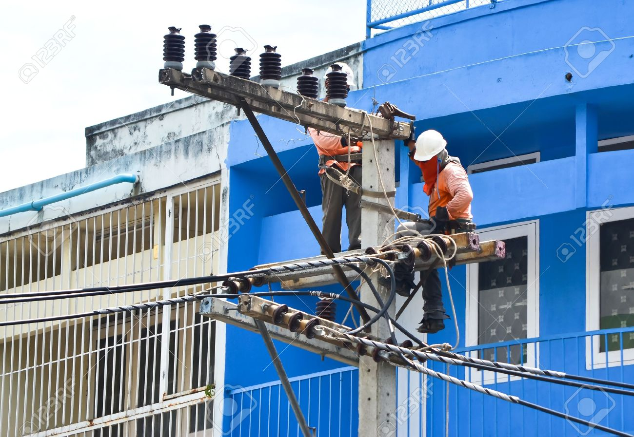 electrician working on electricity post Stock Photo - 16127214