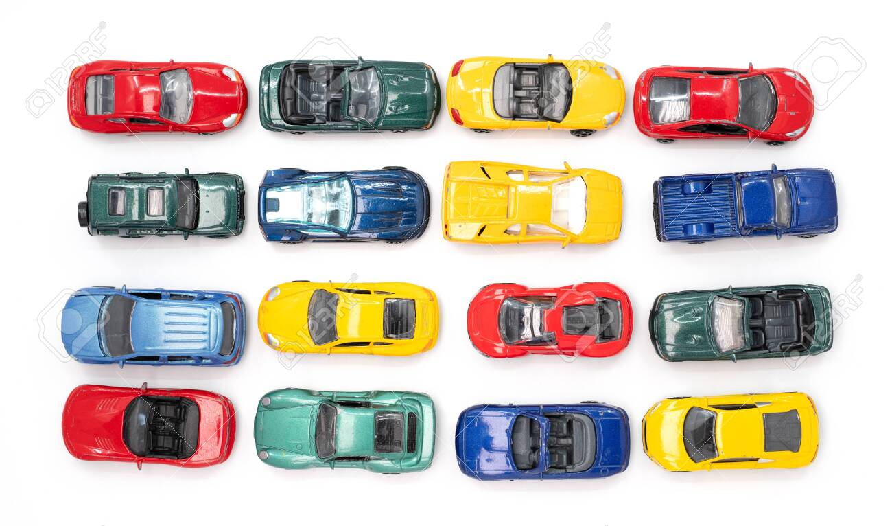 Toy cars in neat rows of the four primary colours - 121425965