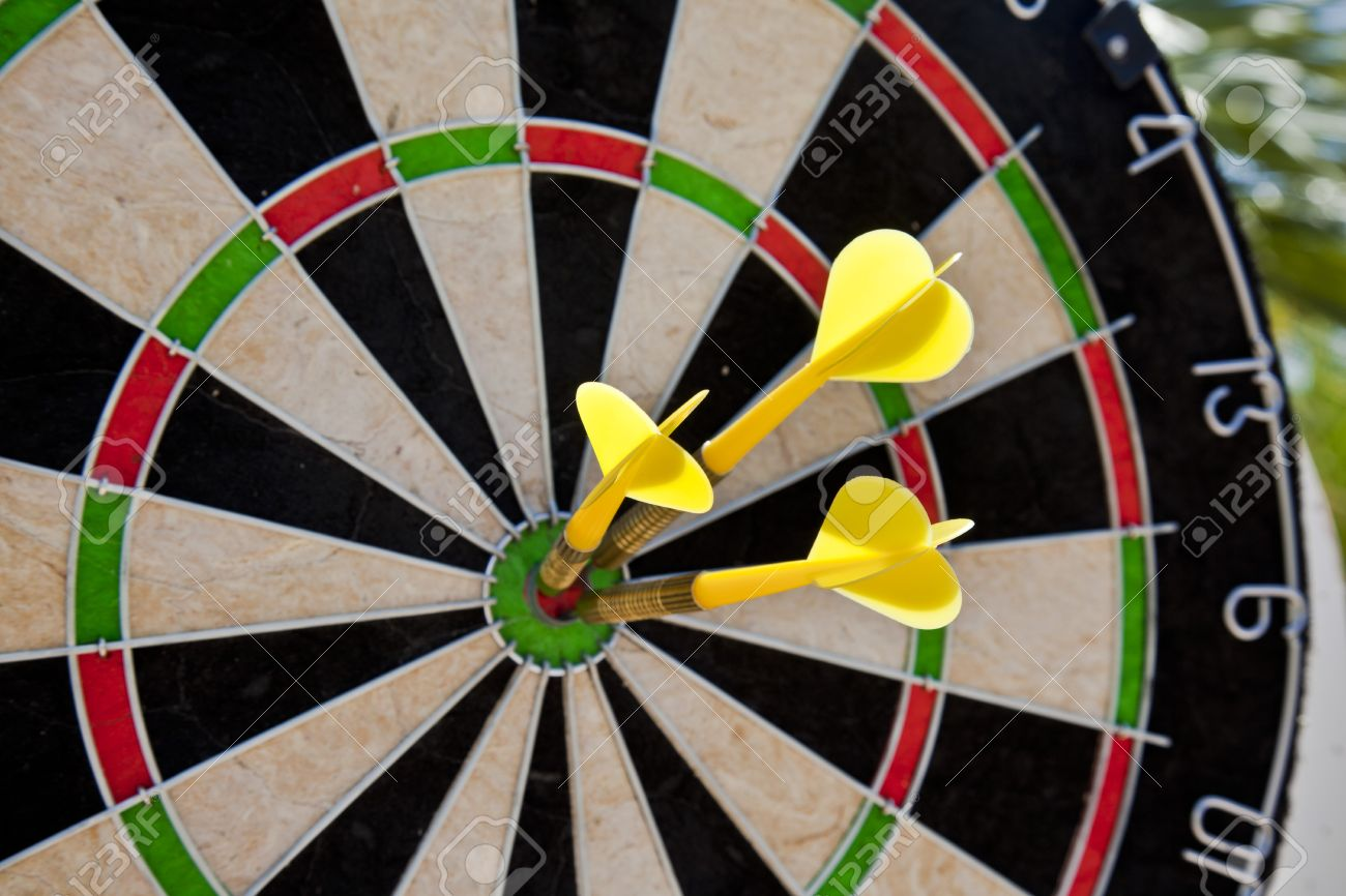 dart board with three darts in bullseye stock photo picture and