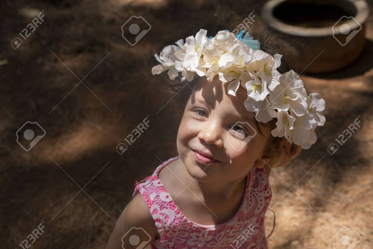 girl smiling with flower crown on head Stock Photo - 106676192 7e8894f4809
