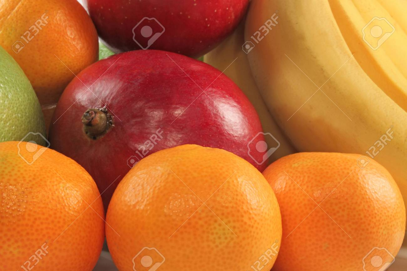 Fresh colorful fruits composition mango; bananas and tangerine Stock Photo - 5941015