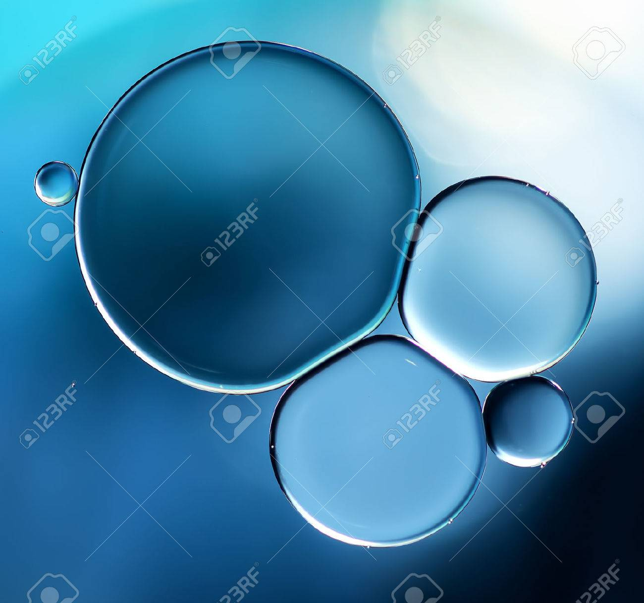 Abstract background, blue oil droplets on water surface. Beautiful macro abstraction - 44225984