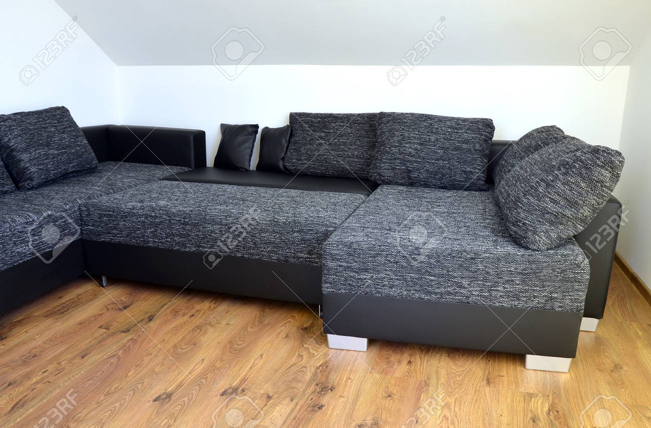 Modern Black And White Cloth Sofa With Black Leather And Pillows