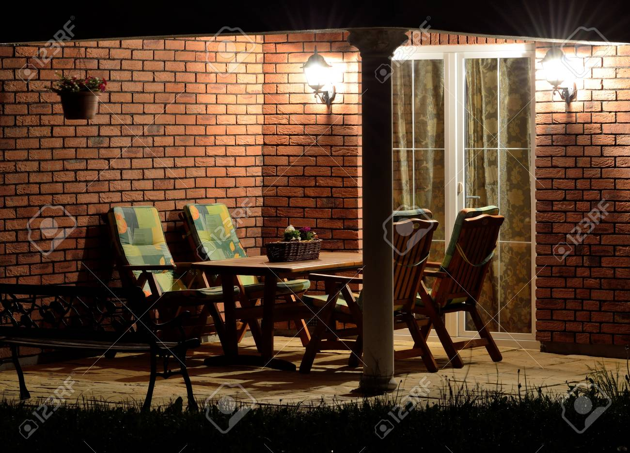 Bricks furniture Sofa Modern House Garden Terrace patio Lined With Bricks With Garden Furniture At Night Lighting Tech Explorist Modern House Garden Terrace patio Lined With Bricks With Garden