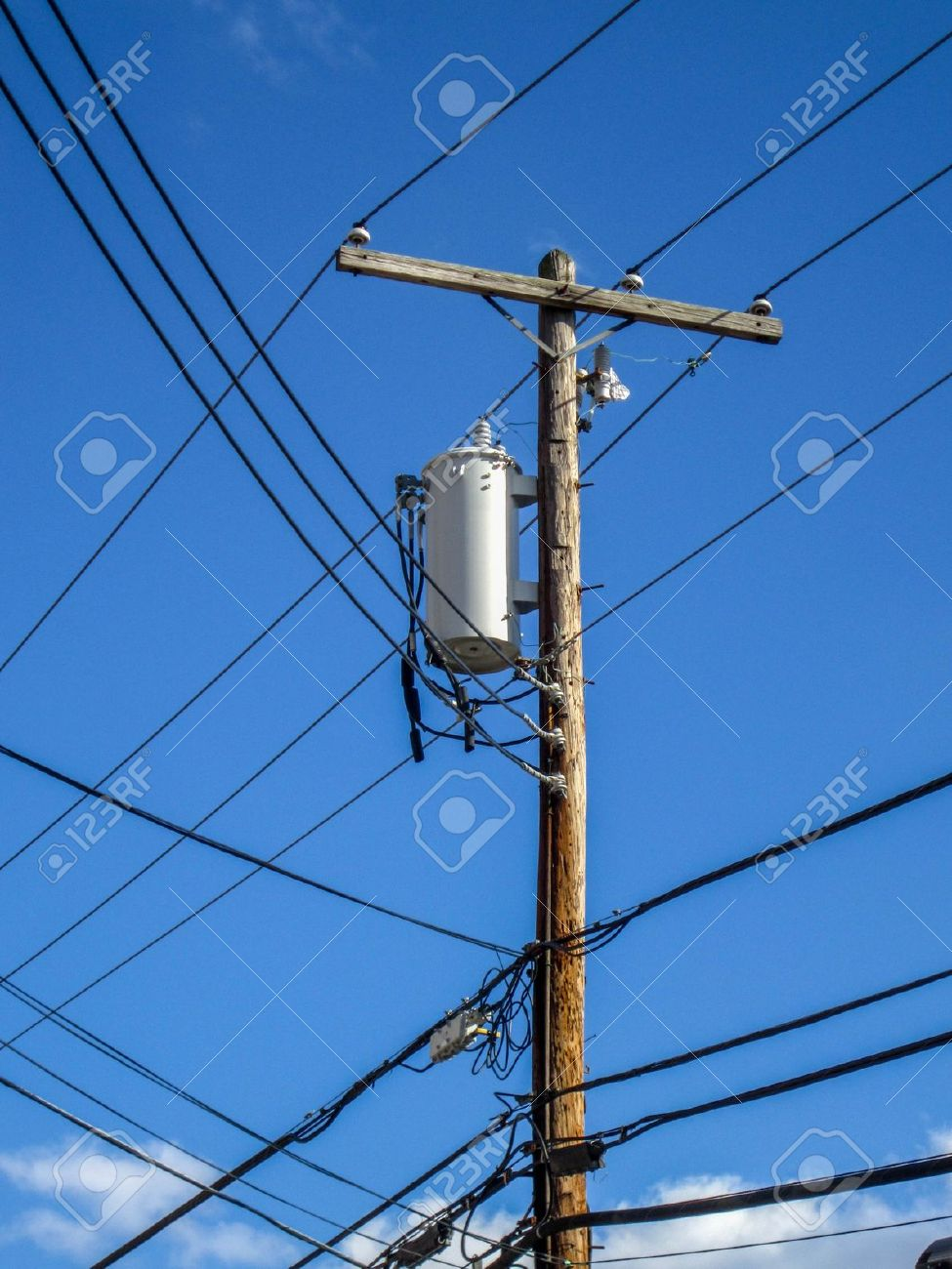 Transformers Of An Electrical Post With Powerlines Against Stock ...