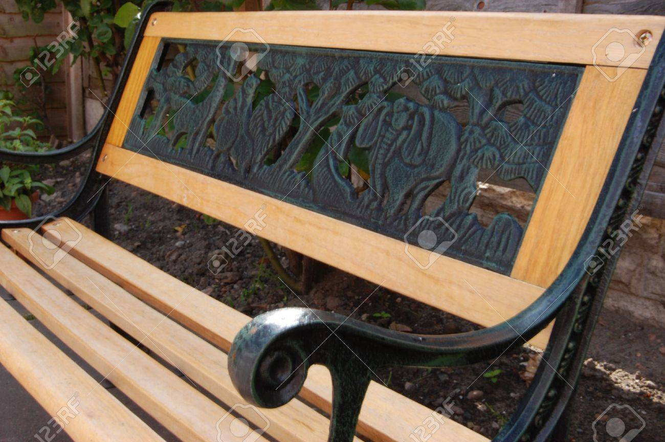 A Kids Small Garden Bench, Made Of Wood And Iron Stock Photo   1141482