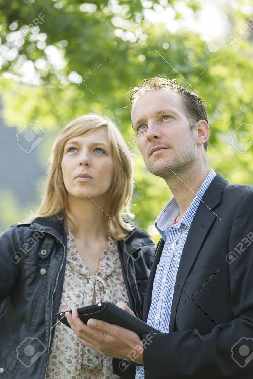 Thoughtful business colleagues with digital tablet Stock Photo - 15451078