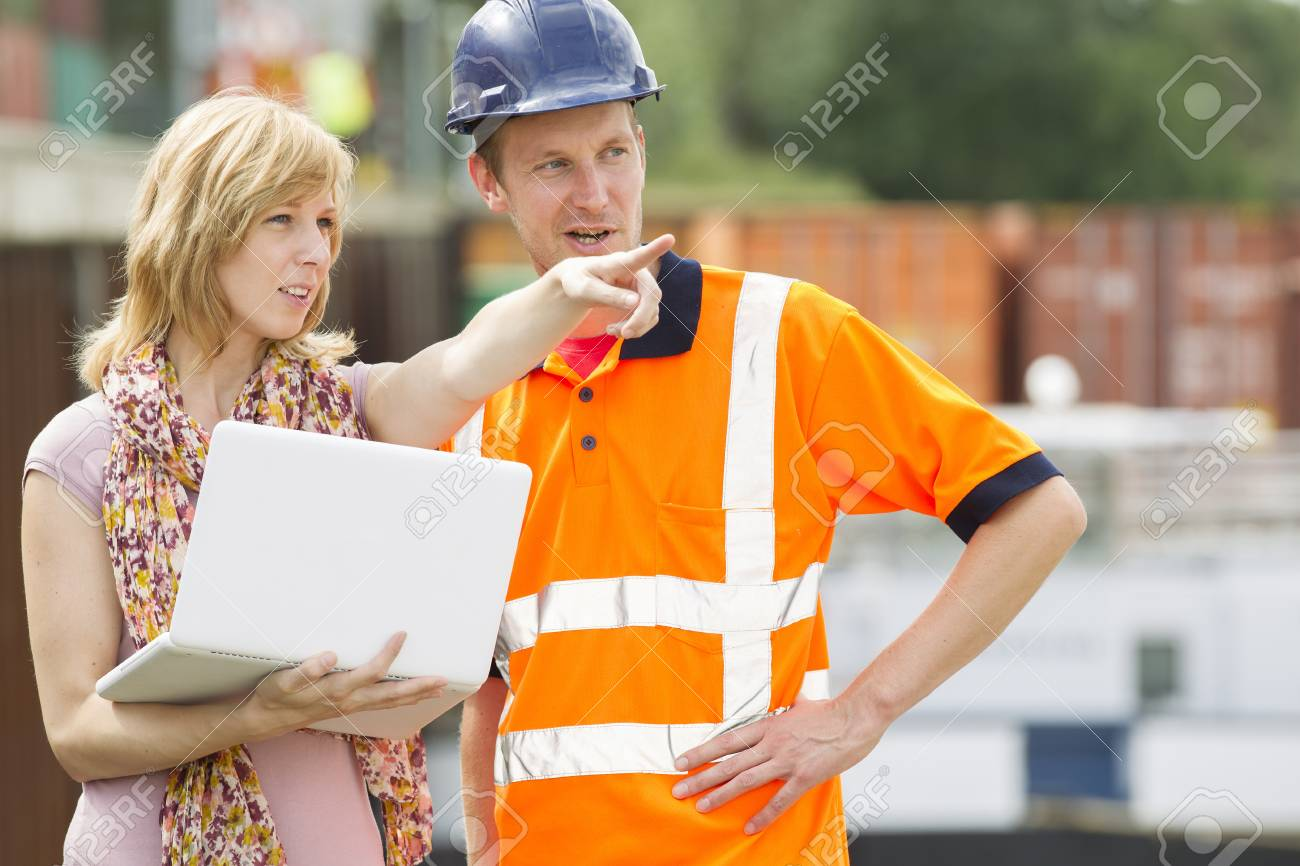 Businesswoman and worker with laptop Stock Photo - 15447665