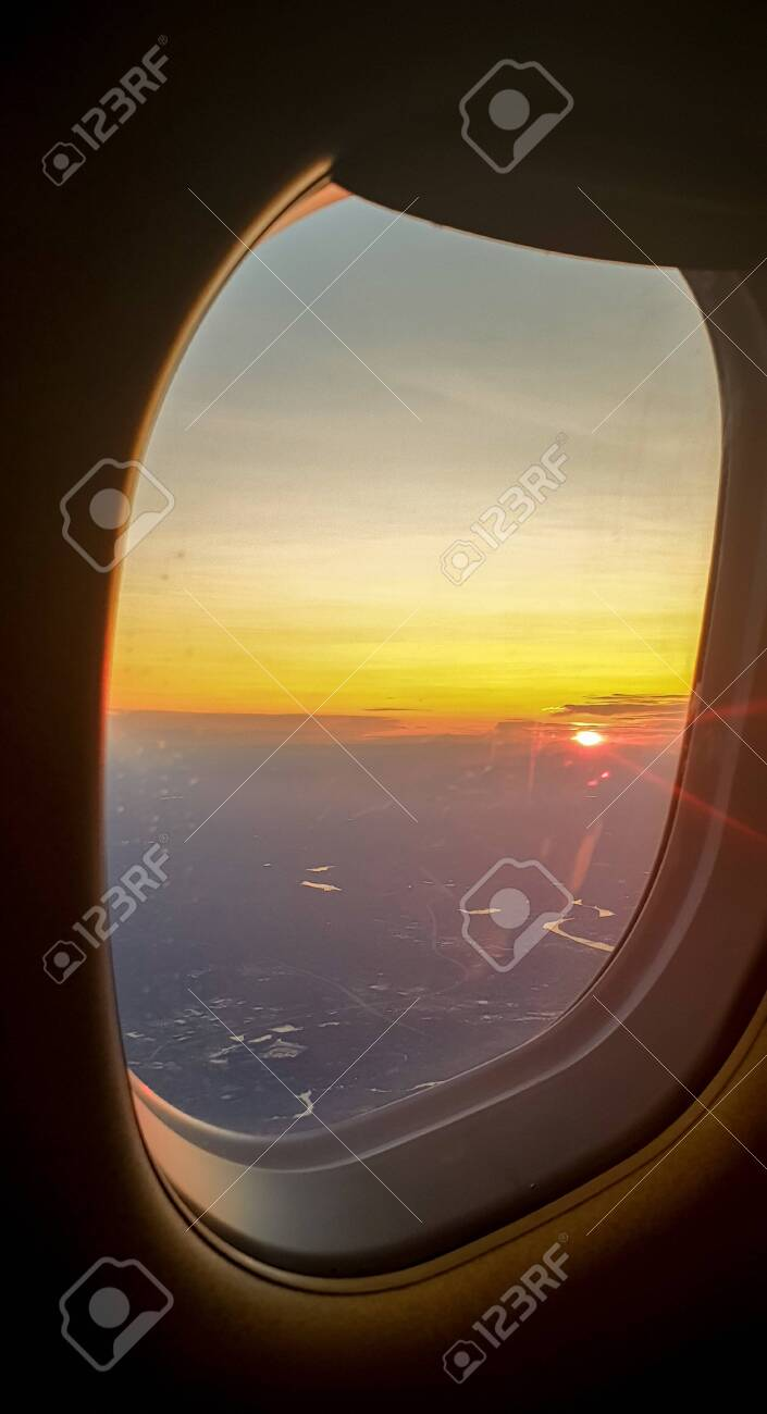 Aerial view from airplane window with the beautiful sky sunset - 129325868
