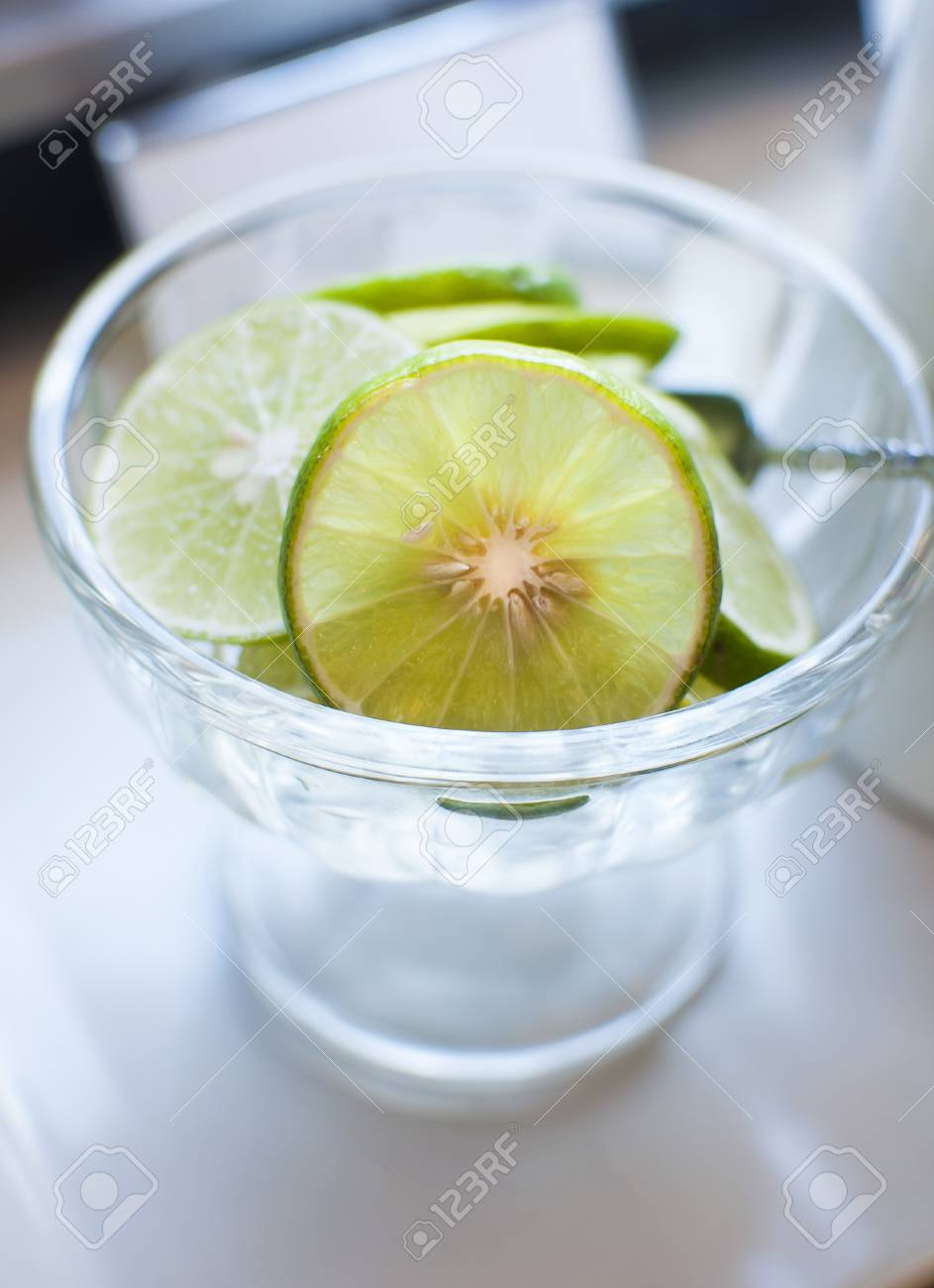 fresh sliced lime in a glass cup for use in drink bar Stock Photo - 17992452