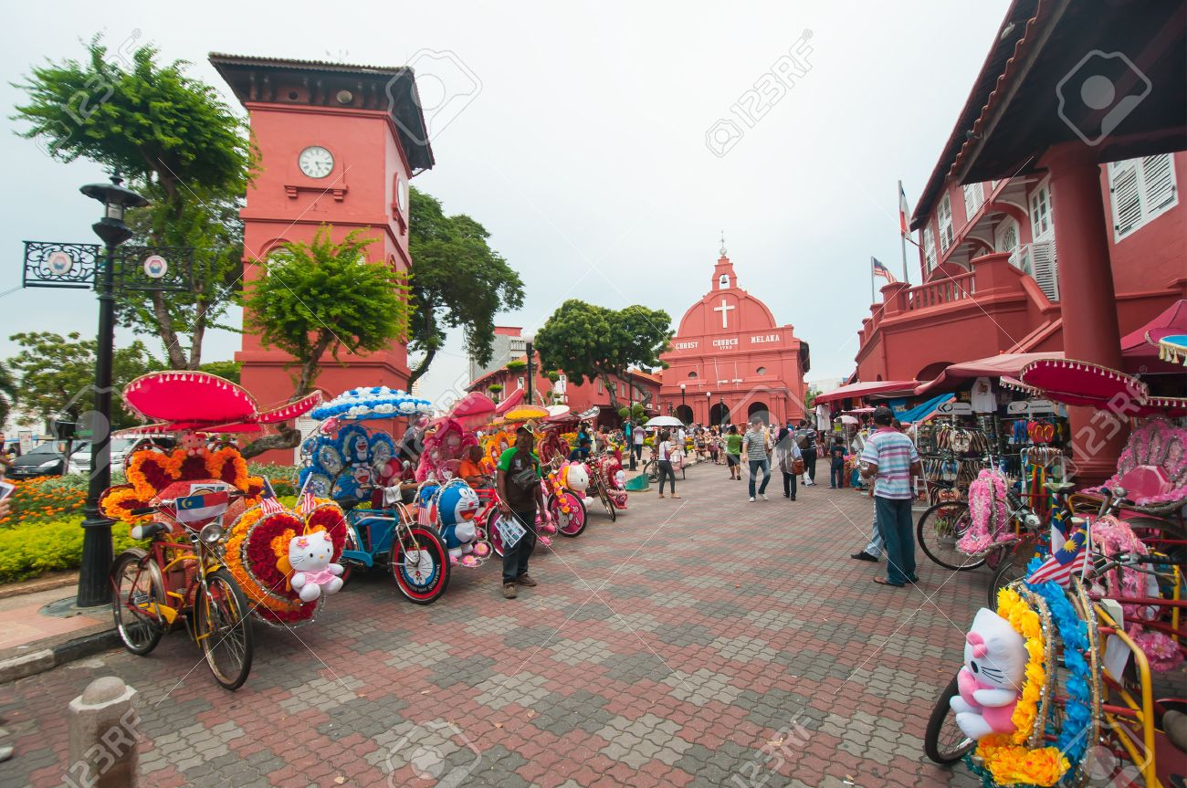 MALACCA, MALAYSIA - NOVEMBER 15,2014: Decorative trishaw at Malacca city Malaysia. A popular historic tourist attraction in Melaka Malaysia with flower decorated tricycles for hire. - 35833021
