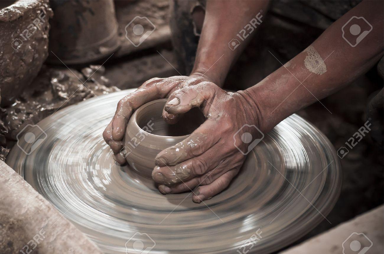 clay pot artisan Artisan hands making clay pot