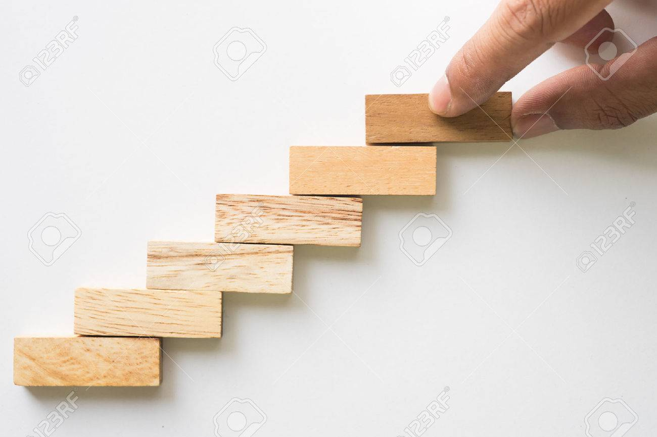Hand aranging wood block stacking as step stair. Business concept for growth success process. - 51981179