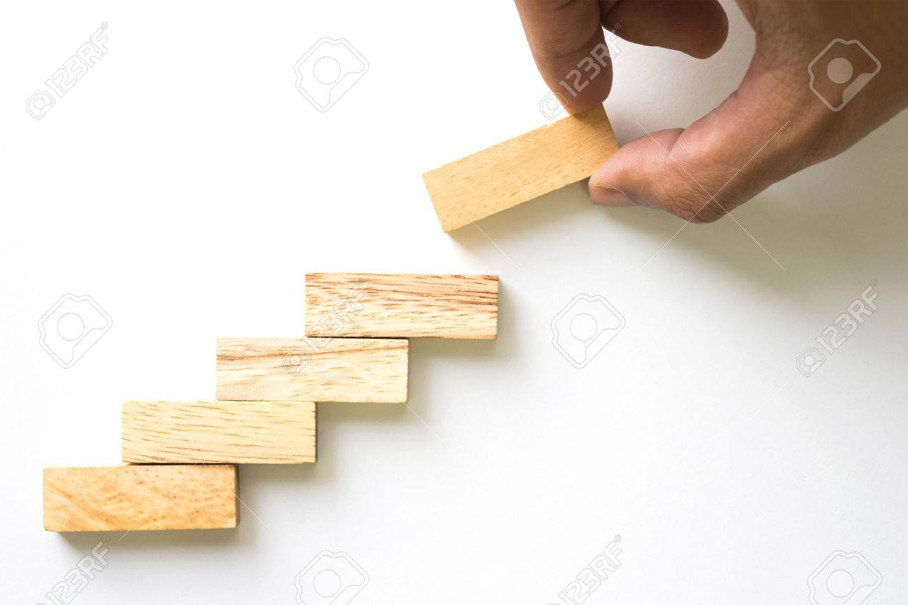 Hand aranging wood block stacking as step stair. Business concept for growth success process. - 53689674