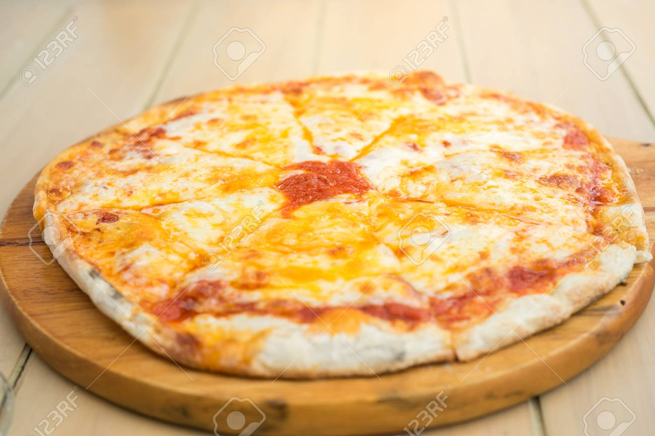 Stock Photo   Yummy Cheese Pizza. Four Cheese Pizza Serve On Wooden Table.  Mouth Watering Melted Cheese Pizza. Classic Cheese Pizza