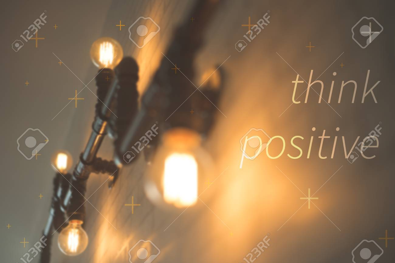 Think Positive Concept. Light Bulb Decoration On Wall Background ...