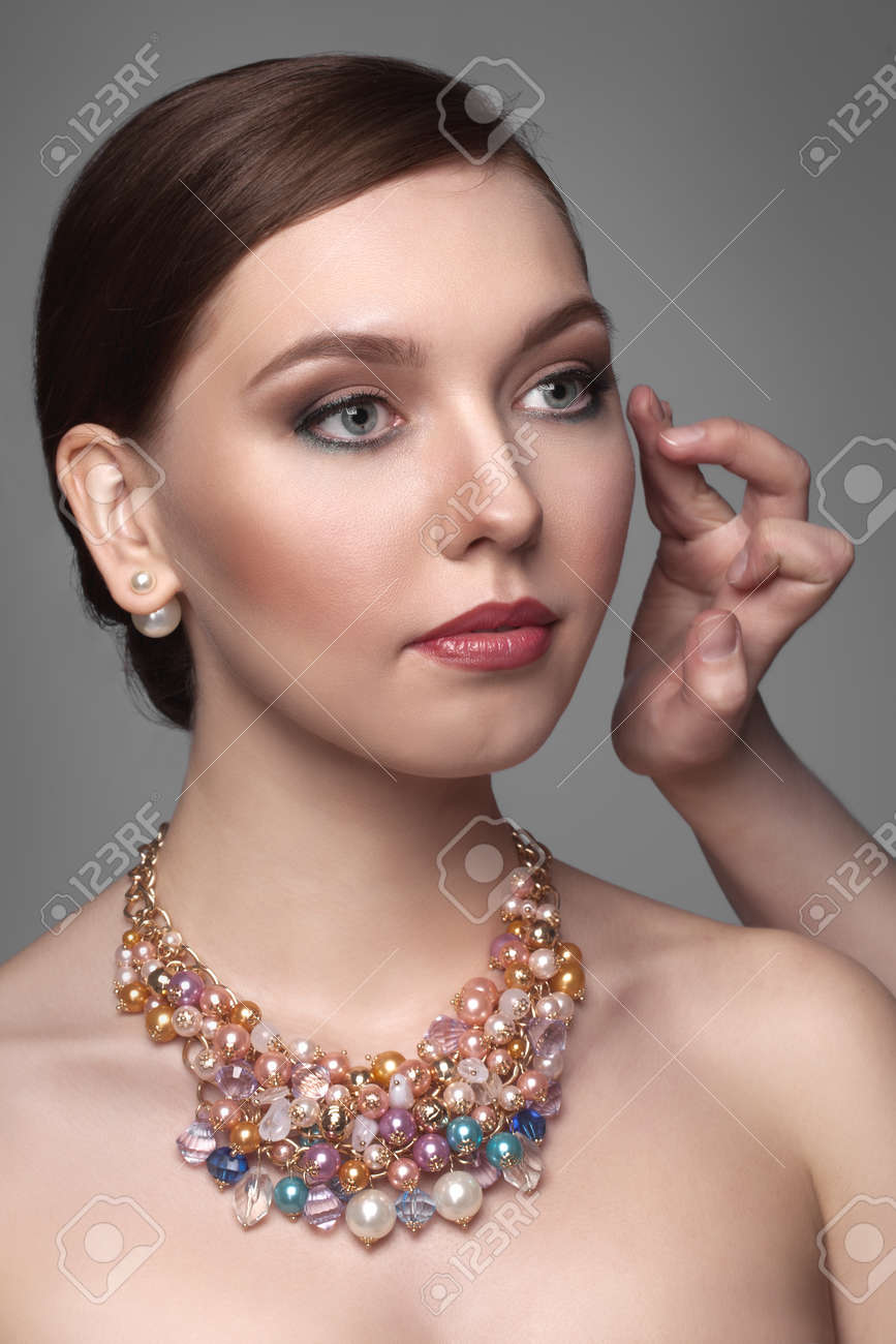 portrait of a beautiful girl in studio on gray background - 155533376