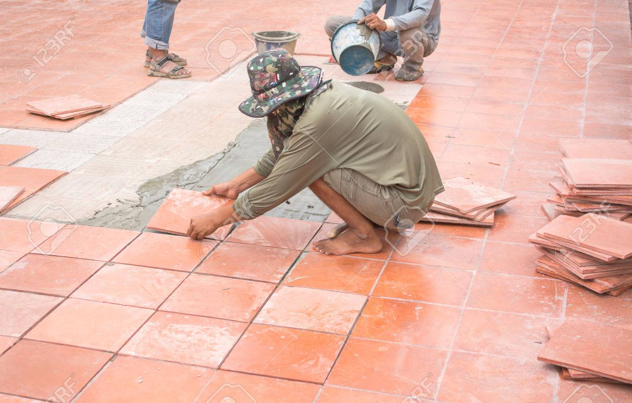 Worker repair floor tile and installation for house building stock worker repair floor tile and installation for house building stock photo 30718279 dailygadgetfo Gallery