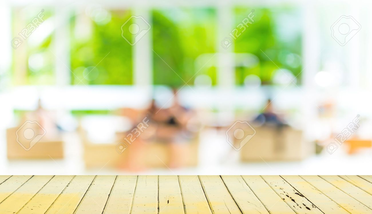 Empty wood table and blurred living room background stock photo - Empty Wood Table And Blurred Living Room Background Stock Photo 34670442