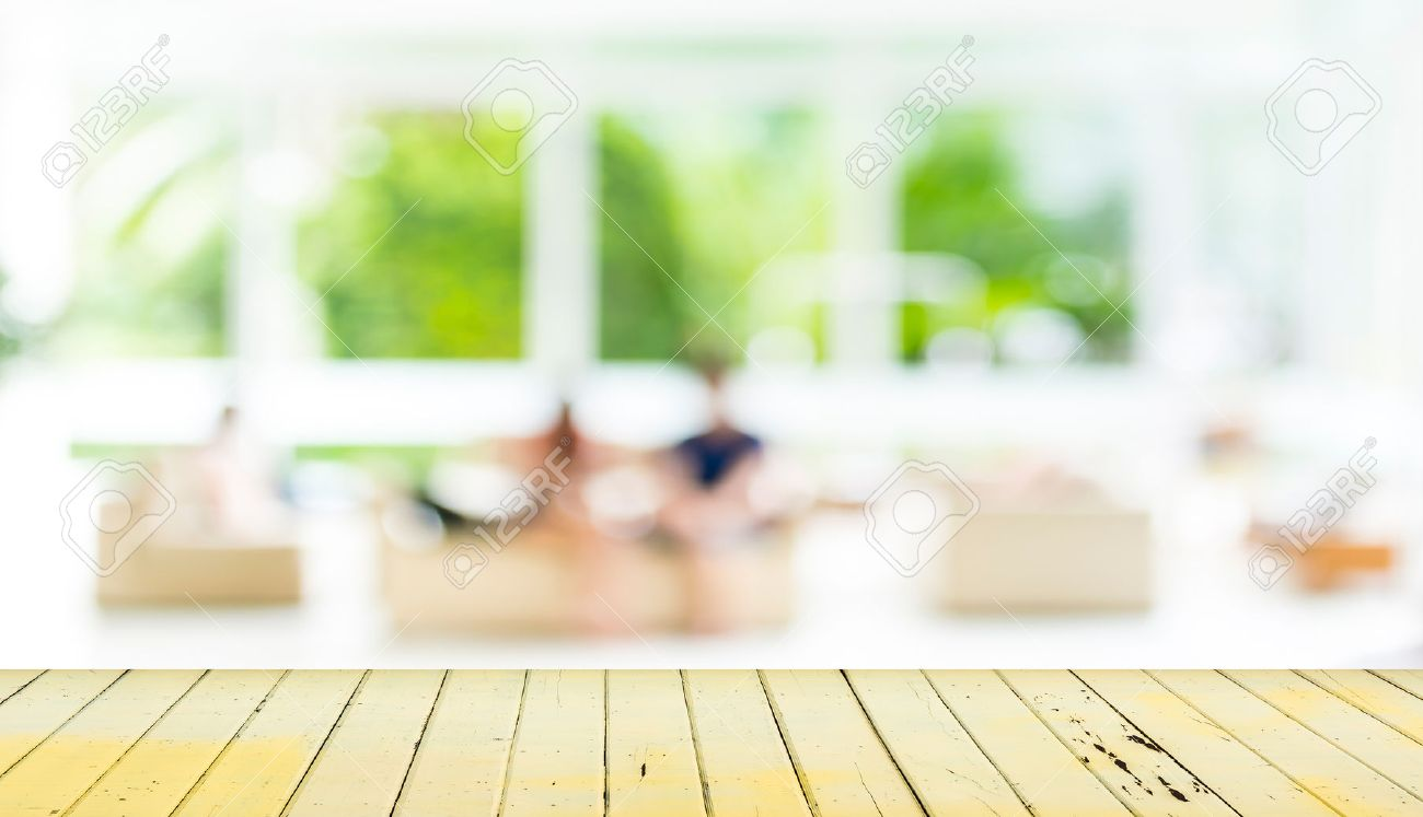 Living Room Background empty wood table and blurred living room background . stock photo