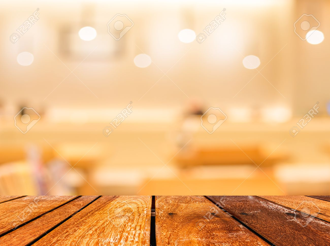 Empty wood table and blurred living room background stock photo - Empty Wood Table And Coffee Shop Blur Background With Bokeh Image Stock Photo 36722043